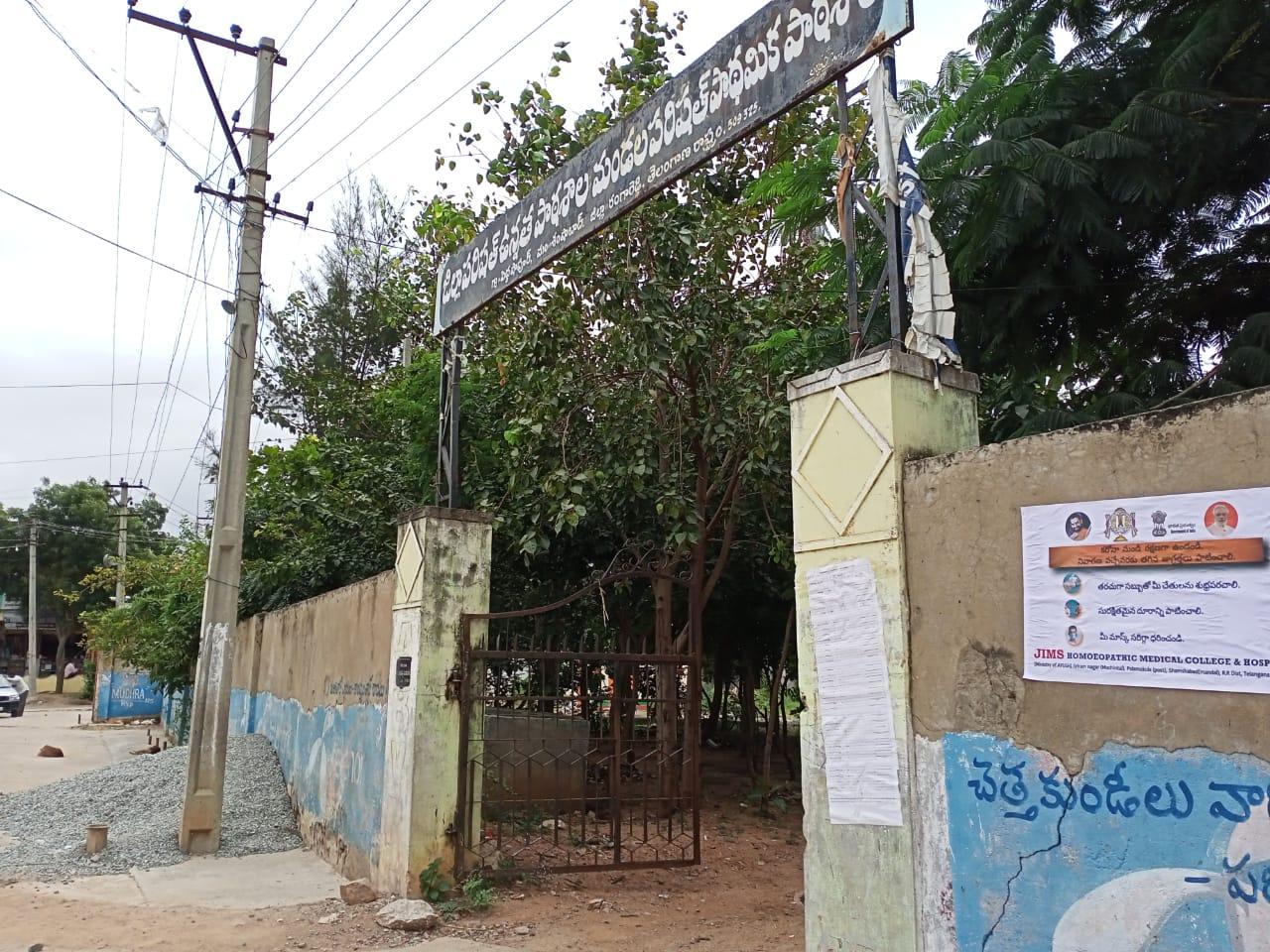 Janandolan Campaign On COVID 19 – IEC poster sticking at Peddashapur of Shamshabad mandal