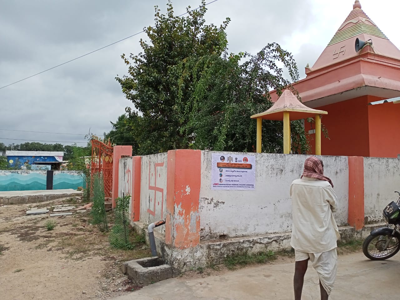 Janandolan Campaign On COVID 19 – IEC poster sticking at Pilloniguda of Shamshabad mandal