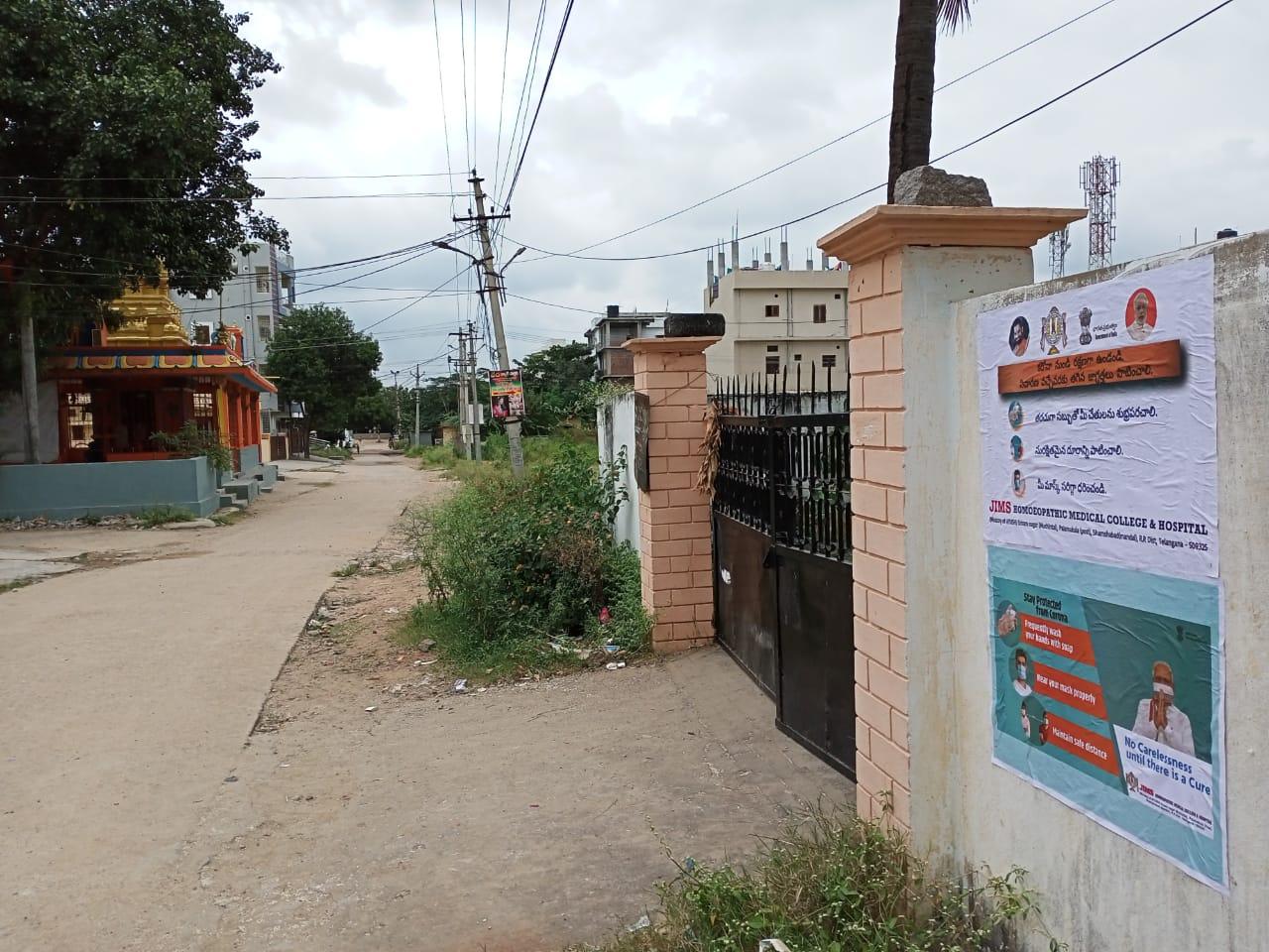 Janandolan Campaign On COVID 19 – IEC poster sticking at Rallaguda of Shamshabad mandal