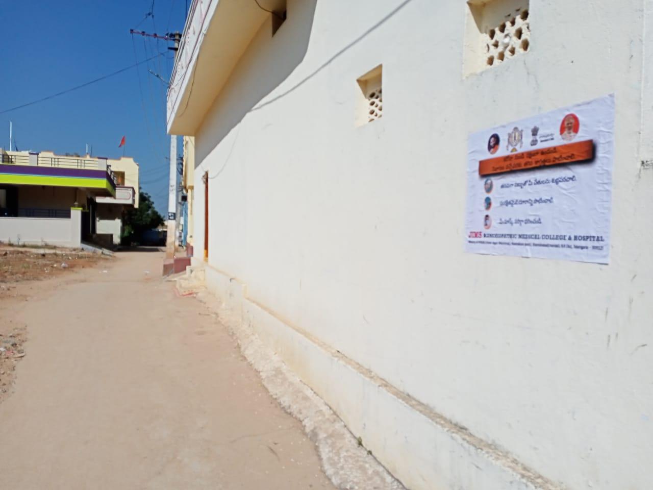 Janandolan Campaign On COVID 19 – IEC poster sticking at Rangapur Village of Kothur Mandal.