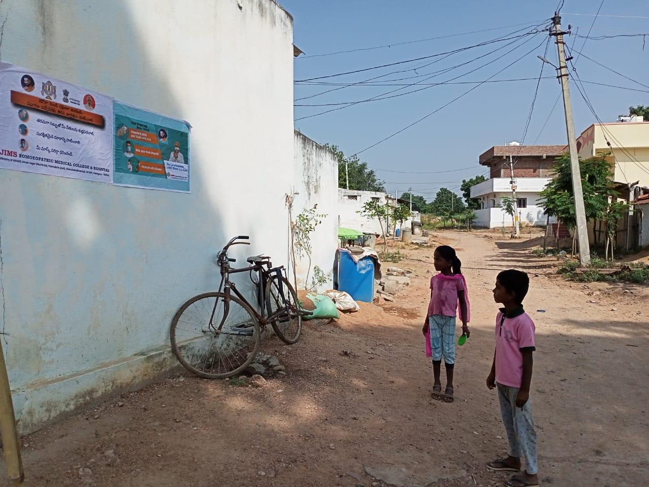 Janandolan campaign on COVID 19 – IEC Poster sticking at Manchan padu village. This is another hamlet village of Modallaguda panchayath