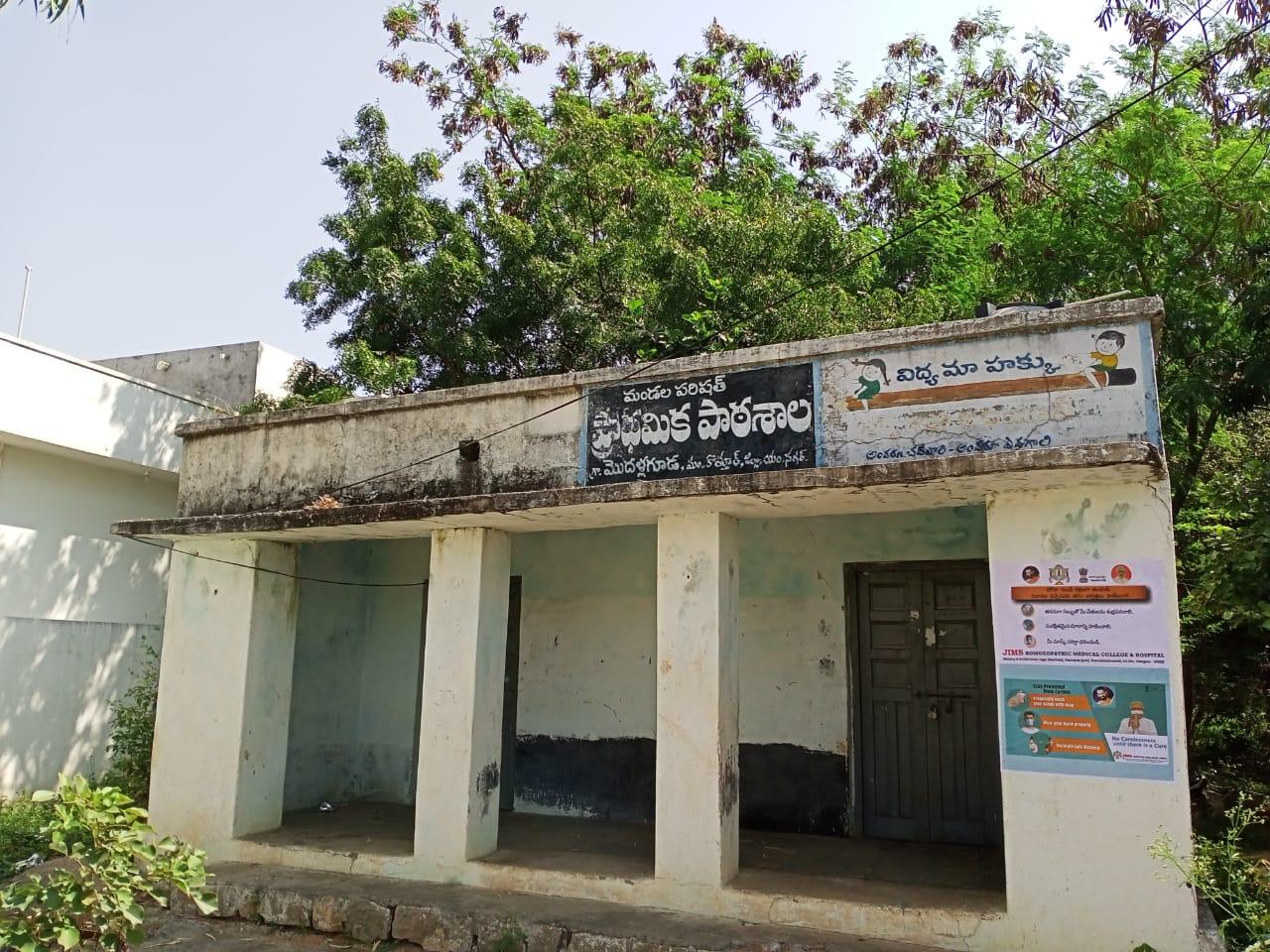 Janandolan campaign on COVID 19-IEC poster sticking at Modallaguda panchayath